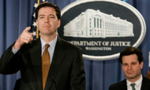 Christopher Wray, who was then assistant attorney general, sits behind James Comey at a news conference in 2004.