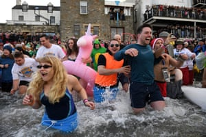 People run into the water of the Firth of Forth for a new year swim