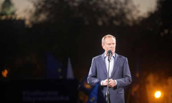 Donald Tusk on stage to address protesters in Warsaw