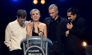 Joff Oddie, Ellie Rowsell, Theo Ellis and Joel Amey of Wolf Alice win the Mercury prize 2018.