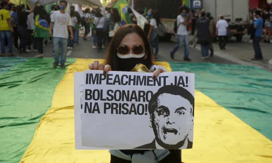 People take part in a protest against the Brazilian president Jair Bolsonaro's handling of the Covid pandemic in São Paulo