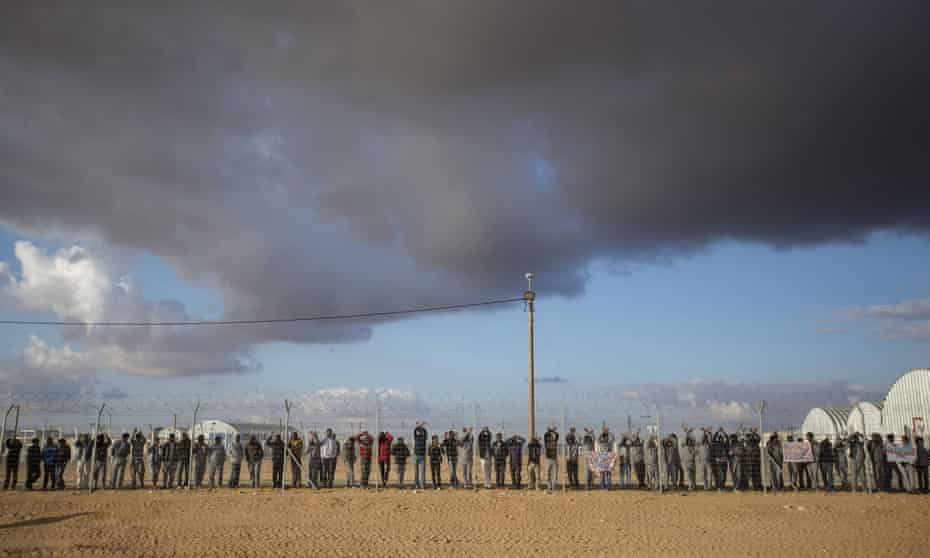 African asylum seekers in Israel gather at the Holot detention centre in the Negev desert.