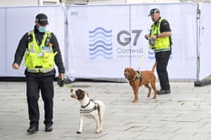 Police dogs with handlers at the G7 media centre in Falmouth