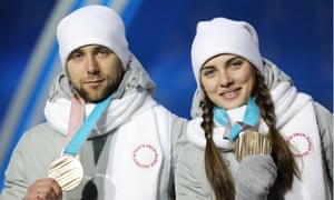 Aleksander Krushelnitckiy and Anastasia Bryzgalova with the bronze medals they won in Pyeongchang as a couple.
