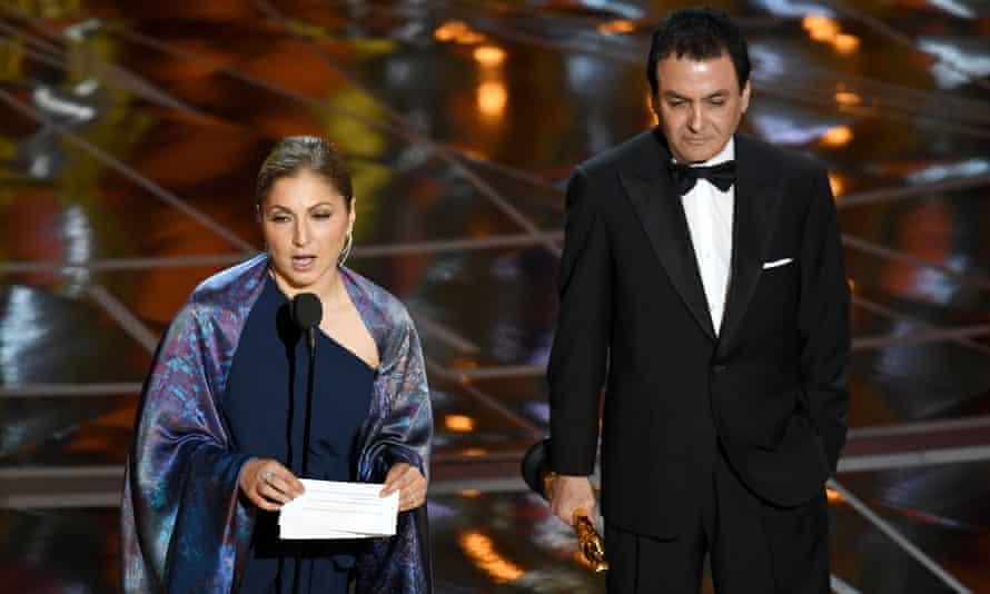 Anousheh Ansari (left) and Firouz Naderi accept the Oscar for best foreign language film for The Salesman on behalf of director Asghar Farhadi
