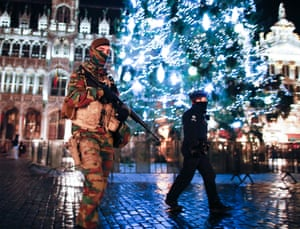 <strong>Brussels, Belgium</strong> Soldiers and police patrol on Grand Place, the city's main square. Brussels remained on high alert for a third consecutive day