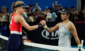 Harriet Dart and Misaki Doi shake hands after their match.