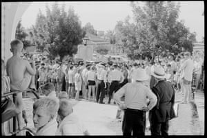 A large crowd forms as police clash with protestors outside Moree Artesian Baths, 17 February 1965