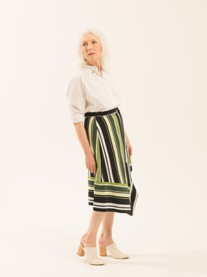 white shirt with embroidered pattern on the front Label Mix/Anne Bernecker from next.co.uk green black and white striped skirt next.co.uk white mules marksandspencer.com , hoop earrings Whistles