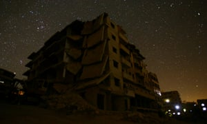 Damaged buildings stand in the rebel-controlled area of Maaret al-Numan in Idlib province.