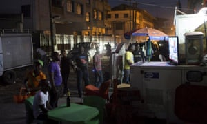 People watch election news coverage on television in Lagos, Nigeria.