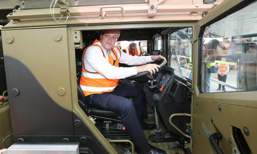 Going nowhere: Scott Morrison sits at the wheel of a a truck during a factory visit in Brisbane in August.