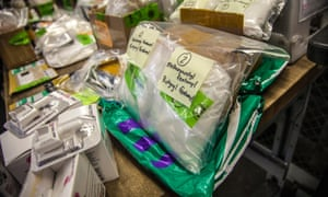 US Customs and Border Protection officers locate fentanyl and other narcotics hidden in a package at the international mail facility in Chicago.