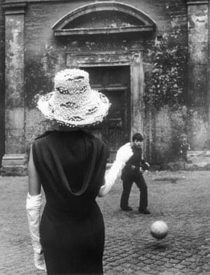 A model and a boy kicking a football
