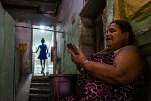 Creozlita Silva do Nacemente monitors who enters and leaves the Manuel Congo squat, Rio