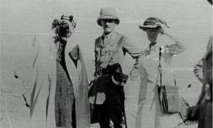 Gertrude Bell with Sir Percy Cox and Ibn Saud, the first king of Saudi Arabia. Basra, April 1916. Bell and Cox, in military uniform, look towards the camera while Ibn Saud scans the distance with a pair of binoculars.