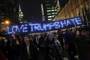 Protestors hold up a sign while marching in Manhattan, New York