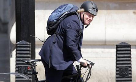 Boris Johnson cycling.