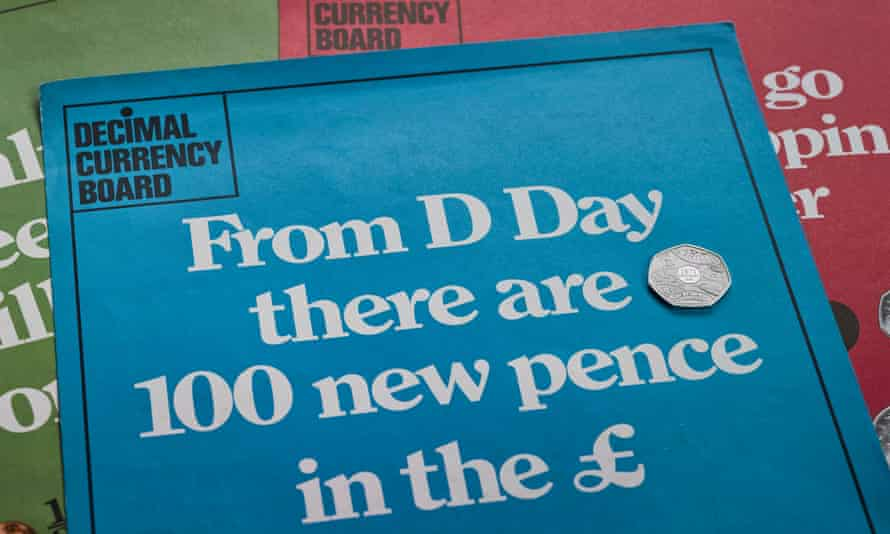 Leaflets produced by the Decimal Currency Board on decimalisation alongside a 50p coin issued by the Royal Mint for the 50th anniversary of Decimal Day