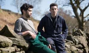 Still from God's Own Country, two young men slumped on dry stone wall