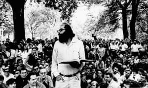 Allen Ginsberg reads one of his poems in Washington Square Park in August 1966.