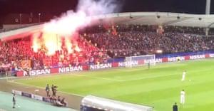 A flare is fired onto the Stadium Ljudski vrt pitch in  Maribor