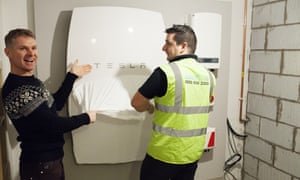 A SolarPlant engineer installs the UK's first Powerwall home battery in Cardiff at Mark Keer and Lyndsey Bennett's home