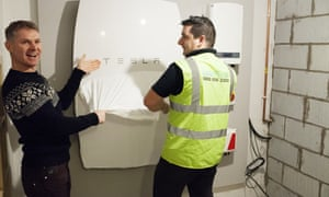 A Tesla home battery being installed at a house in Cardiff.