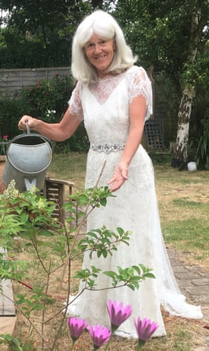 Catherine O'Nolan does a spot of gardening in her wedding dress.