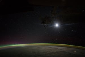 The moon rises over Earth