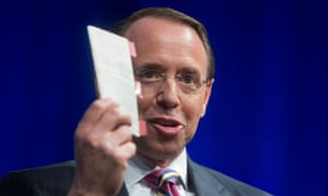 Rod Rosenstein, who is overseeing the special counsel's Russia investigation, holds a copy of the US constitution at an event on 1 May.