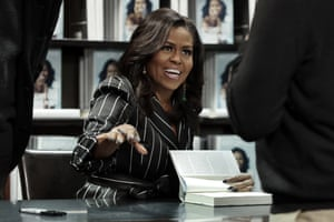 """Michelle Obama<br>FILE - In this Nov. 30, 2018 file photo, former First Lady Michelle Obama signs books during an appearance for her book, \""Becoming,\"" in New York. Obama's book quickly became among the best-selling political memoirs ever. (AP Photo/Richard Drew, File)"""