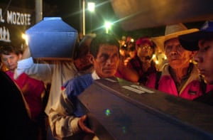 Relatives carry coffins containing the remains of victims in El Mozote in 2000, 19 years after the massacre.