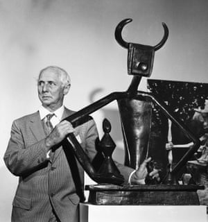 Max Ernst (1891-1976) at the Museum of Modern Art in New York City in 1961, with his bronze sculpture 'The King Playing with the Queen.'