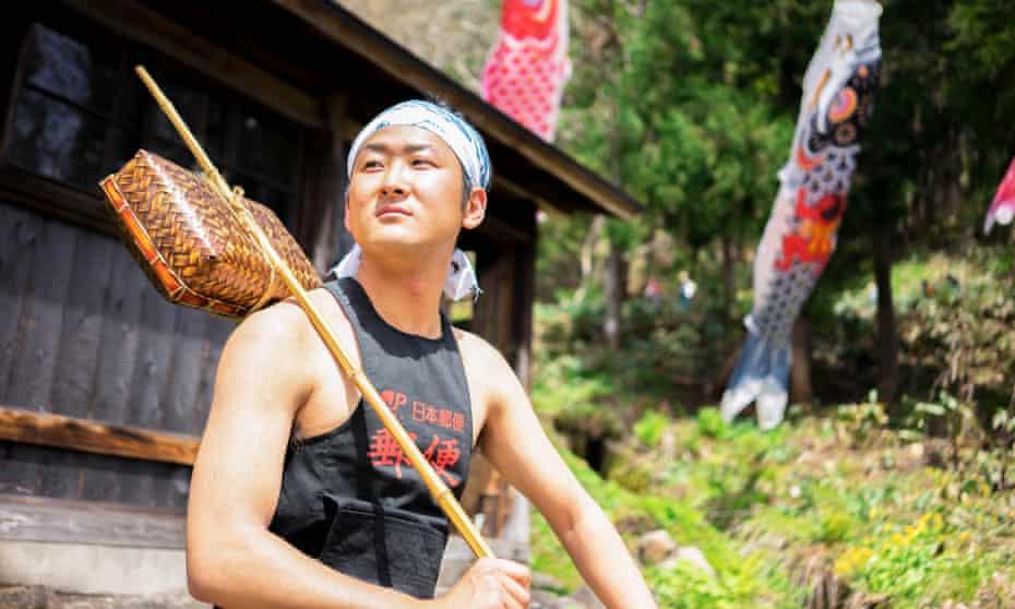 Seigo Fujiwara, a Japan Post deliveryman, from the Otari village annual calendar.