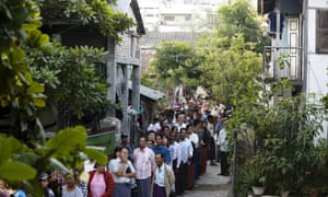 People line up to vote in a mixed Muslim, Buddhist and Hindu neighbourhood in Mandalay on Sunday.
