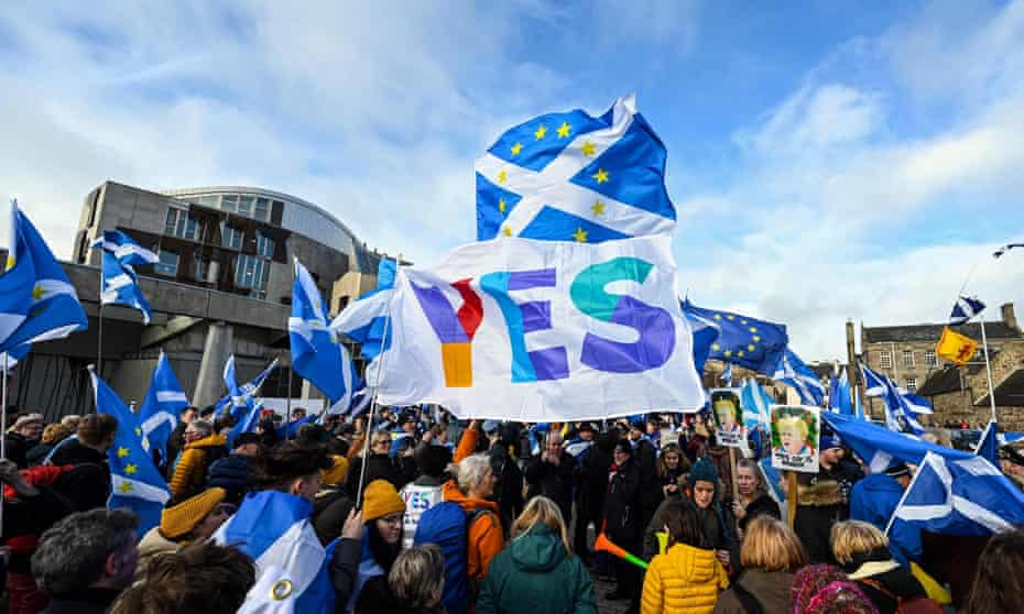 Activists outside Scotland's Holyrood parliament building support independence.