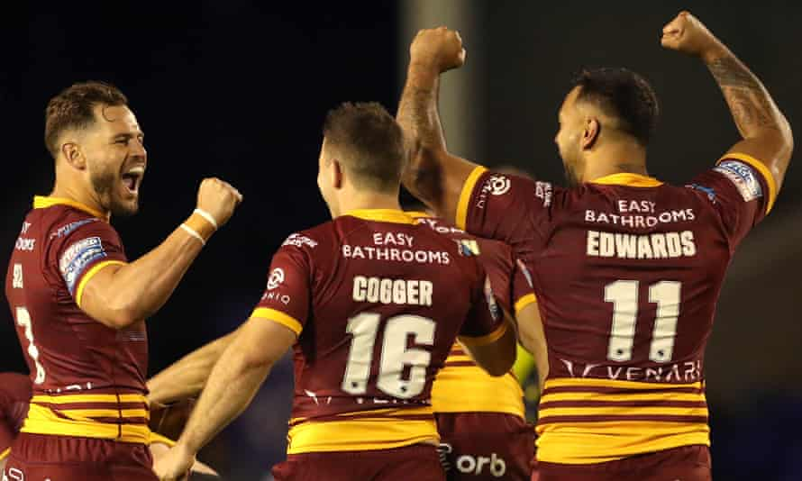 Aidan Sezer, Jack Cogger and Kenny Edwards celebrate Huddersfield's victory after their side held on after flagging following a fine opening half performance.