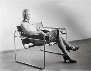 Woman with a mask by Schlemmer seated in one of Marcel Breuer's first tubular steel chairs.