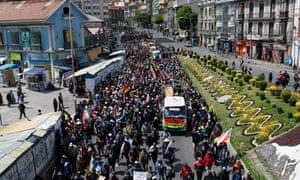 Demonstrators march on central La Paz to protest the killings in El Alto.