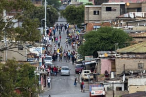 Residents of the densely populated Alexandra township east of Johannesburg gather in the streets on 27 March, apparently disregarding the Covid-19 lockdown.