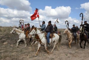 Roderick Dupris on the Cheyenne River Reservation rides with other Fort Laramie treaty riders along Van Tassel Road in Torrington, Wyoming