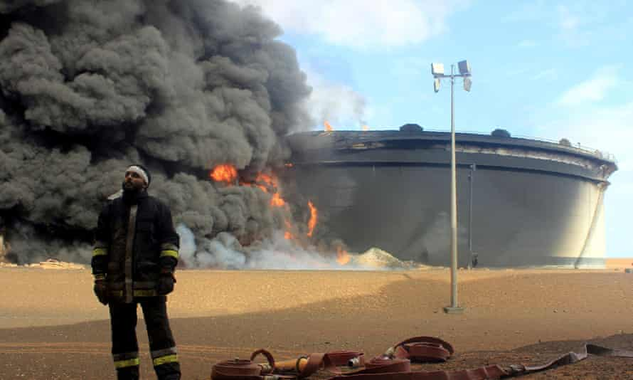 Burning oil storage tank