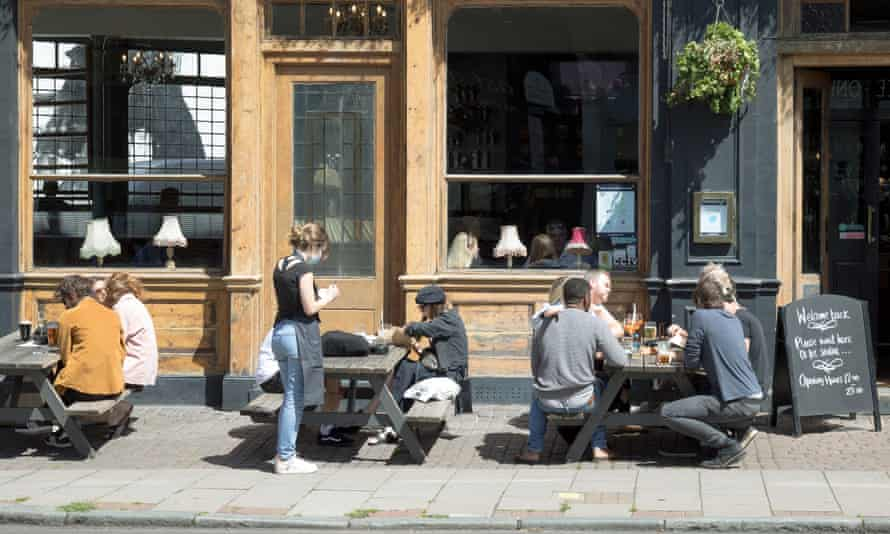 Customers outside a pub in south London