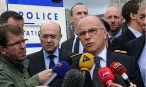 French interior Bernard Cazeneuve at the police station where the murdered officer worked.
