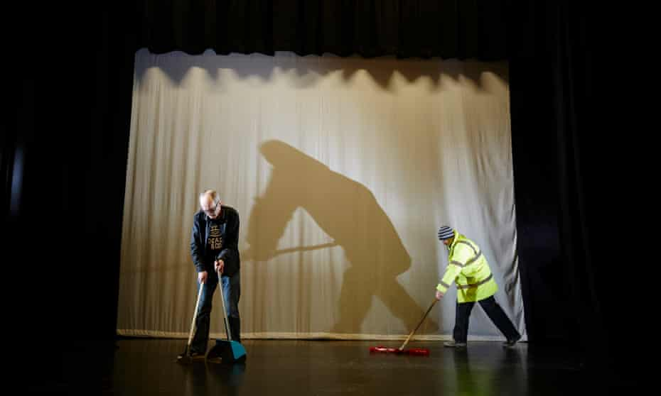 Walsh helps mop the stage at the Freedom Centre to earn more HullCoin credits.