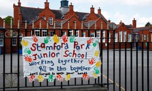 A banner painted by children on the railings of Stamford Park junior school, Altrincham.