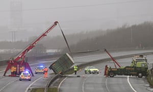 Recovery vehicles work to right an overturned lorry on the M4 between Bridgend and Port Talbot, south Wales