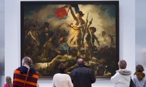 People look at Eugène Delacroix's painting Liberty leading the people