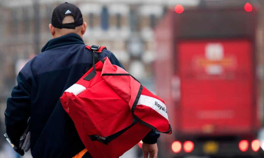 A postal worker leaves the Royal Mail Mount Pleasant sorting office in London